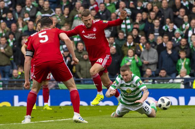 HeraldScotland: Aberdeen defender Mikey Devlin trips Jonny Hayes and Celtic are awarded a penalty