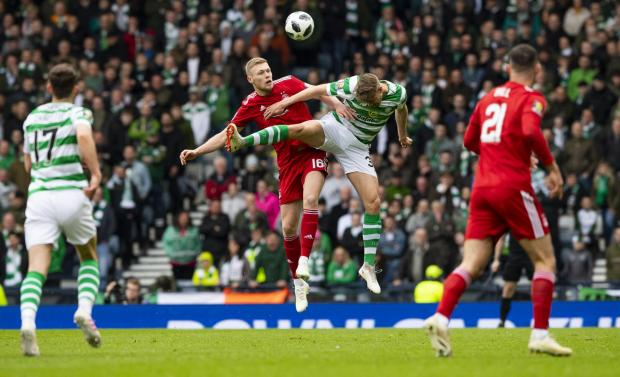 HeraldScotland: Sam Cosgrove and Kristoffer Ajer battle for the ball