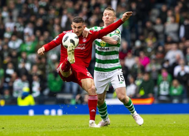 HeraldScotland: Jonny Hayes tries to stop Dominic Ball clearing the ball