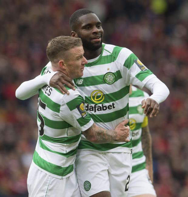 HeraldScotland: Jonny Hayes hugs Odsonne Edouard after the Frenchman netted from the spot for Celtic versus Aberdeen