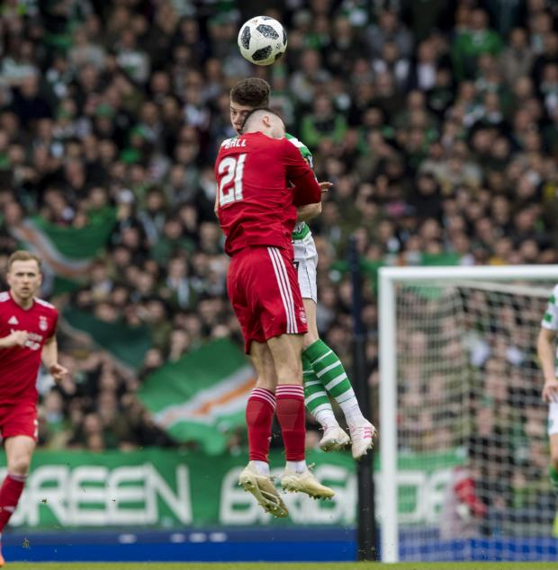 HeraldScotland: Dominic Ball clatters into Ryan Christie
