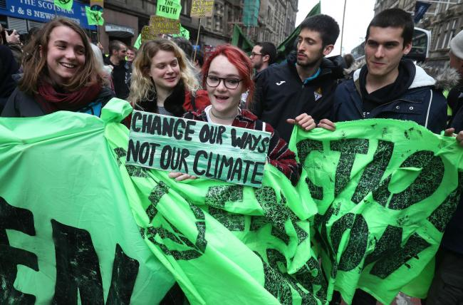 Climate protesters join Extinction Rebellion Scotland as they form a road block on the North Bridge in Edinburgh. PRESS ASSOCIATION Photo. Picture date: Tuesday April 16, 2019. See PA story ENVIRONMENT Climate. Photo credit should read: Andrew Milligan/P