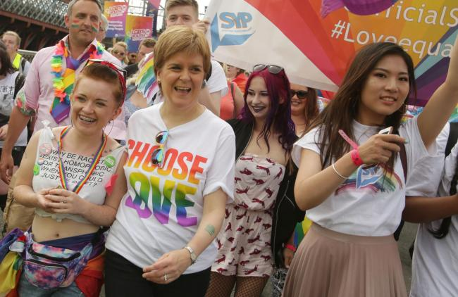First Minister of Scotland Nicola Sturgeon joins .people taking part in Pride Glasgow, Scotland's lesbian, gay, bisexual, transgender and intersex (LGBTI) pride event in Glasgow. PRESS ASSOCIATION Photo. Picture date: Saturday July 14, 2018. See PA st