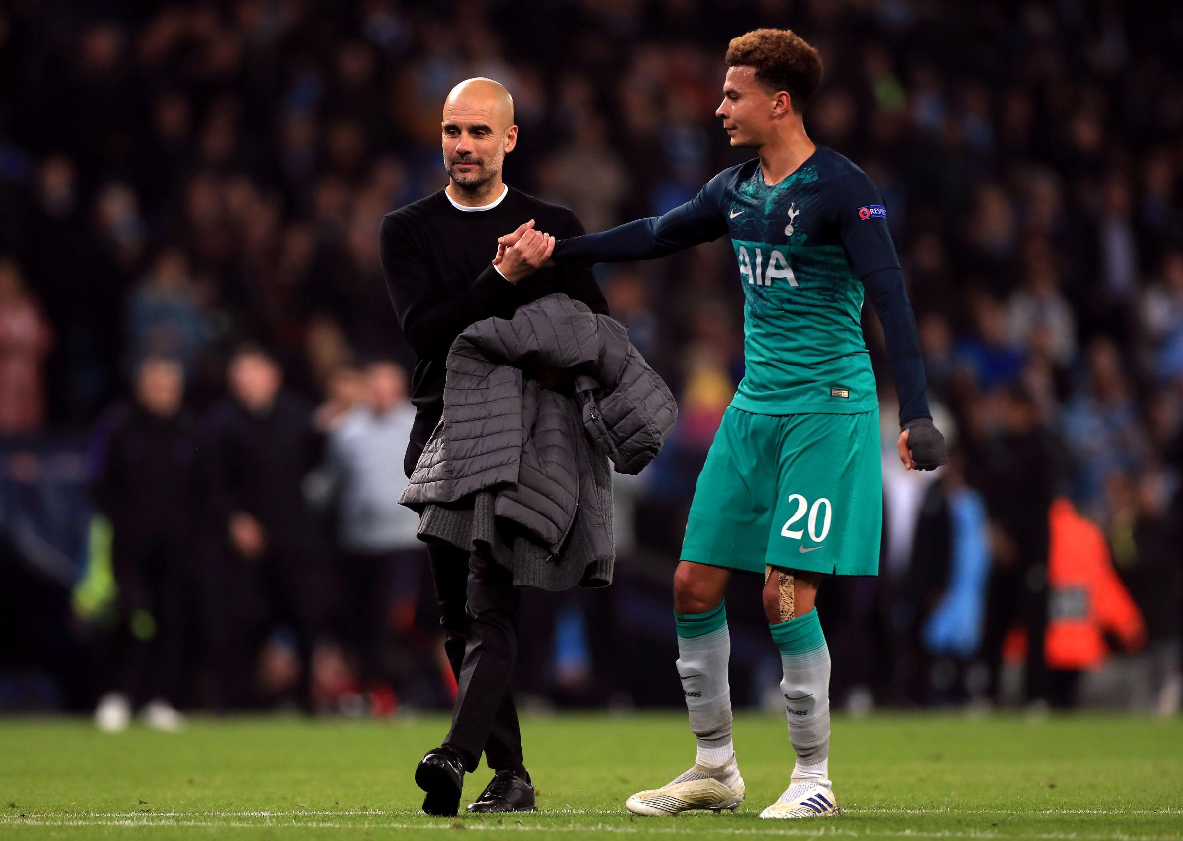 Manchester City manager Pep Guardiola and Tottenham Hotspur's Dele Alli after the UEFA Champions League quarter final second leg match at the Etihad Stadium, Manchester