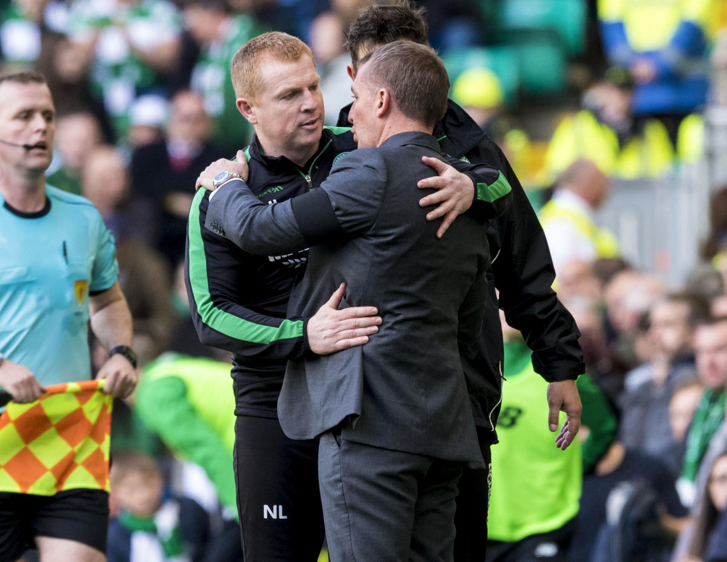 Neil Lennon, in his tracksuit, is a very different character to Brendan Rodgers with his designer suits