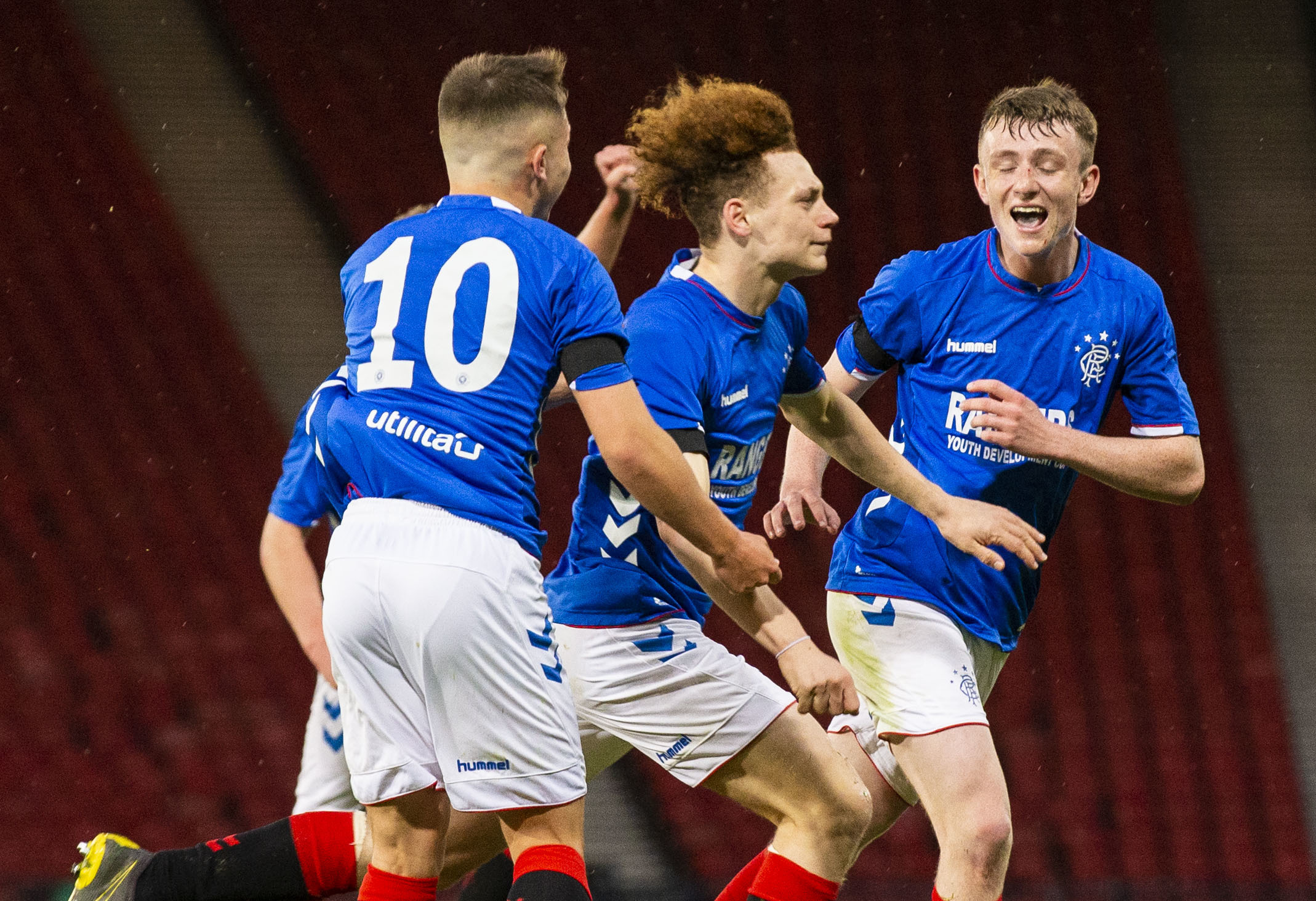 Rangers' Nathan Young-Coombes celebrates after he heads home his side's third goal
