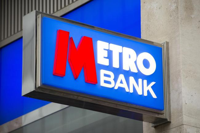 A Metro Bank sign hangs above a branch window, Central London. PRESS ASSOCIATION Photo. Picture date: Saturday February 14, 2015. See PA story  . Photo credit should read: Laura Lean/PA Wire