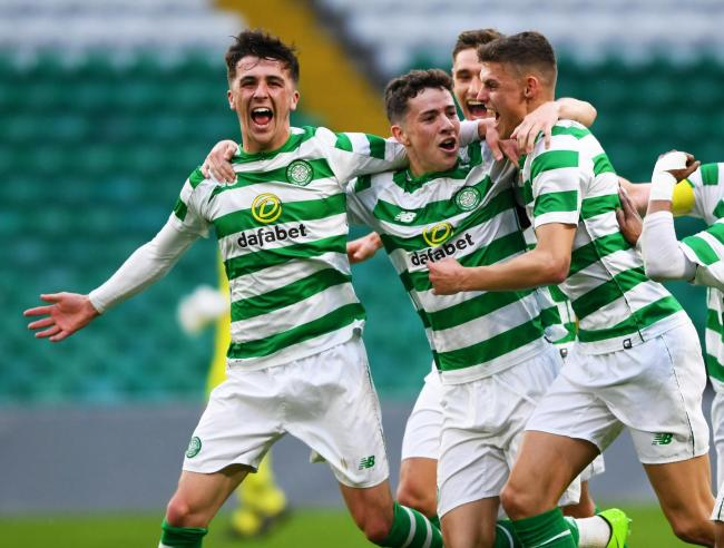 Celtic's Michael Johnston (C) celebrates his goal with his team mates