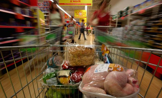People shop in a supermarket