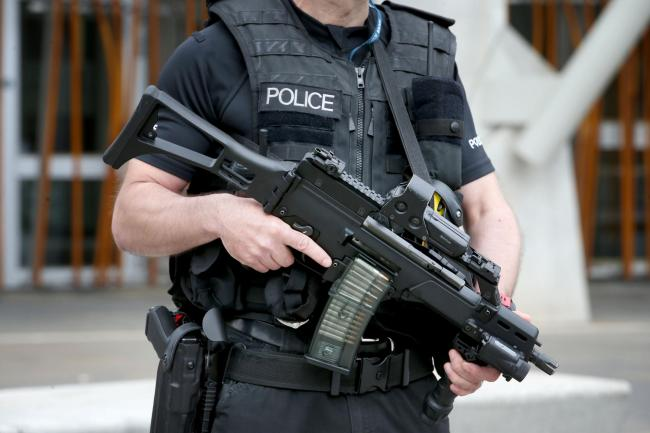 Armed police on patrol outside the Scottish Parliament