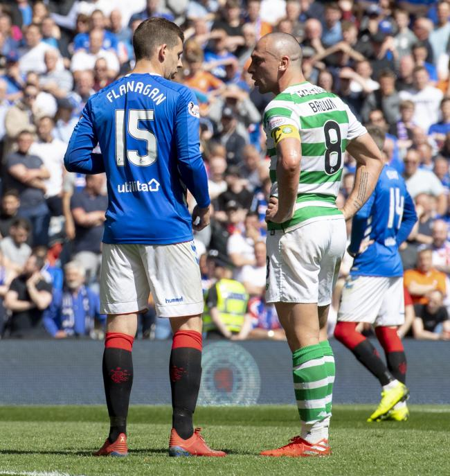 Jon Flanagan and Celtic captain Scott Brown exchange words