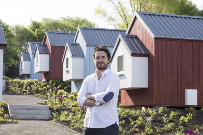 Josh Littlejohn, Social Bite co-founder in front of NestHouses at the Social Bite Village in Edinburgh  Pic:  Jeff Holmes/PA Wire