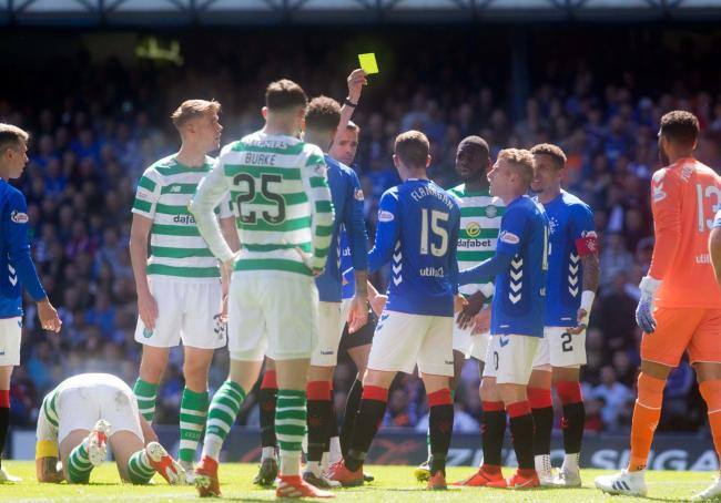 Jon Flanagan is booked for an altercation with Scott Brown (floor) during the Ladbrokes Scottish Premiership match at Ibrox