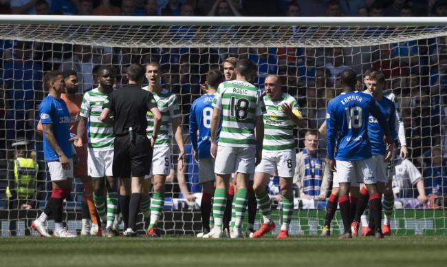 The Celtic players appeal to referee Kevin Clancy after Jon Flanagan is booked for catching Scott Brown