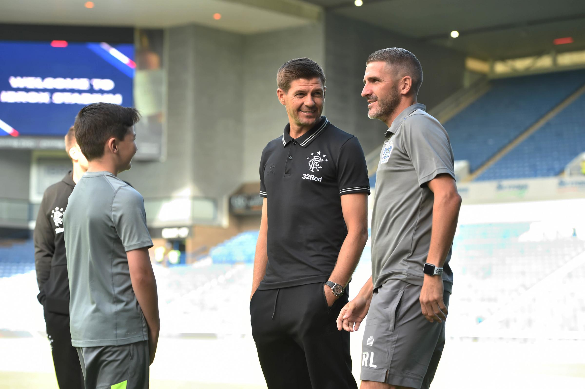 Rangers manager Steven Gerrard (L) with Bury manager Ryan Lowe