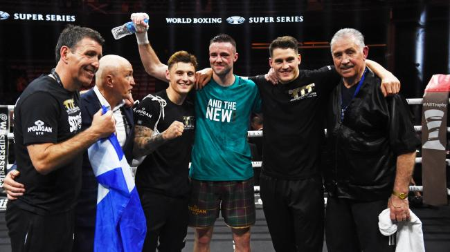 Josh Taylor celebrates his points win over Ivan Baranchyk with his team including Shane and Barry McGuigan. Pic: SNS