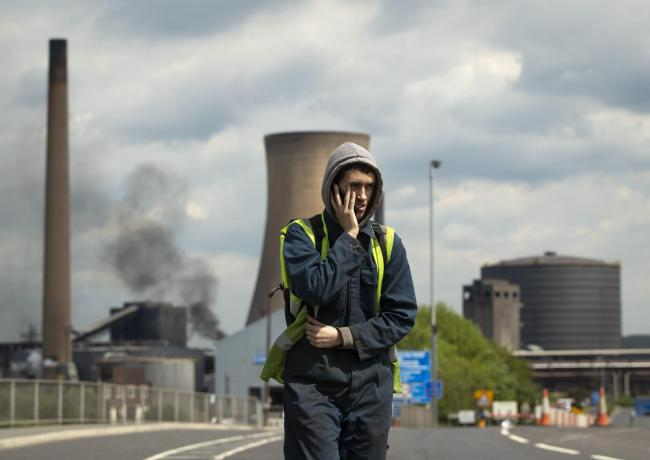 A worker leaves the British Steel plant at Scunthorpe as the firm falls into administration.