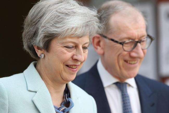 May and husband Philip at polling station: disastrous Tory result will add pressure on PM to go