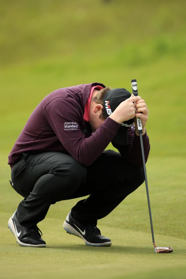 Robert MacIntyre reacts to a missed putt in Denmark