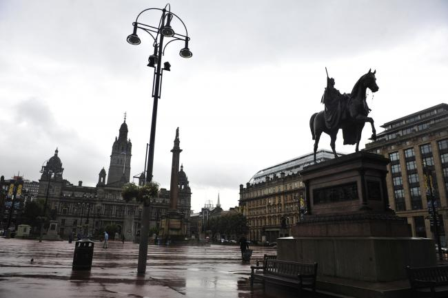 Photo Jamie Simpson.  .Glasgow City Council are removing some of the statues in George Square for cleaning and restoration-JS.Pictured: Queen Victoria statue with George Square in the background.