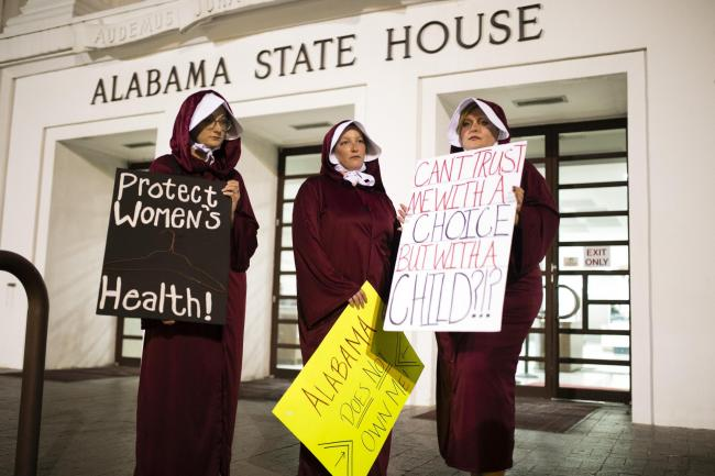 Women wearing Handmaid's Tale costumes protest in Alabama, which banned abortions earlier this year. Picture: Getty Images