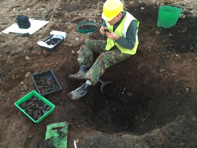 Early Neolithic pit during excavation showing pottery finds