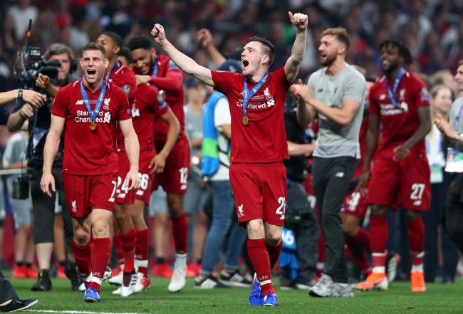 MADRID, SPAIN - JUNE 01: James Milner and Andy Robertson of Liverpool celebrate wearing their winners medals following the UEFA Champions League Final between Tottenham Hotspur and Liverpool at Estadio Wanda Metropolitano on June 01, 2019 in Madrid, Spain