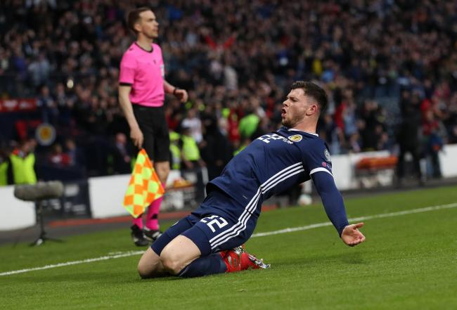 Oliver Burke celebrates after his last-gasp winner for Scotland.