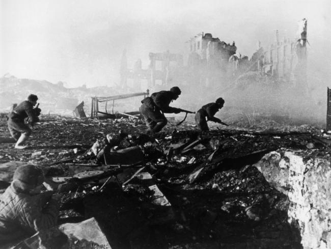 Red Army troops storm an apartment block amidst the ruins of war-torn Stalingrad in 1941. Picture: Getty Images