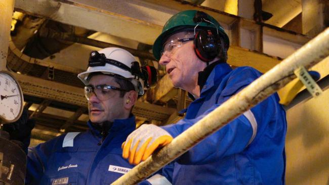 Serica Energy chief executive Mitch Flegg, right, on the Bruce production platform around 200 miles north east of Aberdeen
