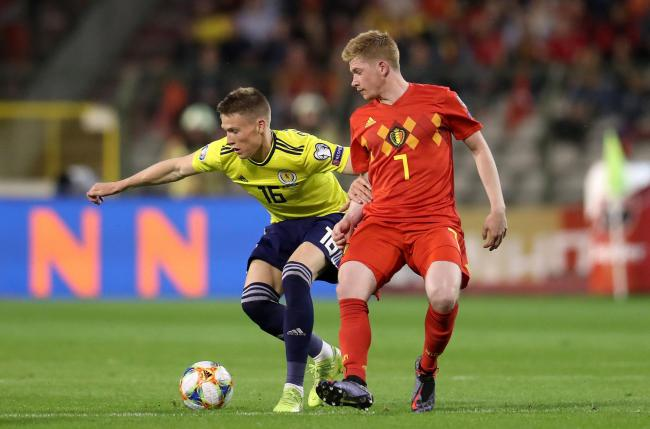 Scotland's Scott McTominay (left) and Belgium's Kevin De Bruyne battle for the ball during the UEFA Euro 2020 Qualifying, Group I match at the King Baudouin Stadium