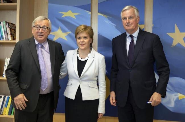 Scotland's First Minister Nicola Sturgeon with European Commission President Jean-Claude Juncker, left, and European Union chief Brexit negotiator Michel Barnier prior to a meeting at EU headquarters in Brussels
