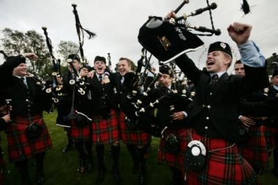 COCK-A-HOOP: Field Marshal Montgomery Band celebrate their title win on Glasgow Green, above, where all ages of both sexes took part in the World Championships.  Pictures: Steve Cox