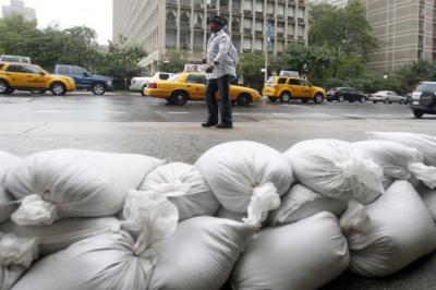The US National Guard lined New York streets with sand bags while                       residents were evacuated as Hurricane Irene threatened the city with storm surges                                                                                                                                           Photograph:  Mike Groll/AP Photo