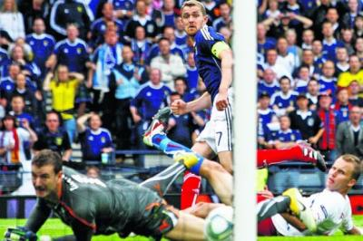 Darren Fletcher gives Scotland a 2-1 lead but his team's joy was shortlived  Photograph: Stewart Attwood