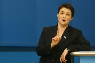 Ruth Davidson, main picture, has sacked her aide, Ross McFarlane, pictured top right with David Cameron, after a video was passed to this paper showing him burning an EU flag, top left and centre