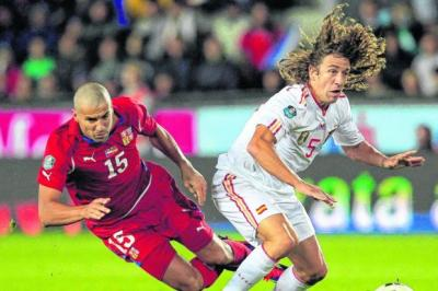 Carles Puyol comes away with the ball as the Czechs' Milan Baros takes a tumble, Picture: Reuters