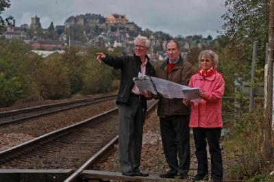 RAIL ROW: Norman McIntosh, Councillor Ian Brown and his wife, Ethne, look at the site for the planned cleaning depot. Picture: Gordon Terris