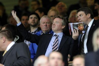 bullish: Craig Whyte has issued a warning over allegations about his business life and, below, appeared on television to defend his job at Rangers. Main picture: James Galloway