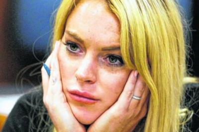 TAGGED: Lindsay Lohan has been sporting her sobriety  tag, bottom right, for the past year.