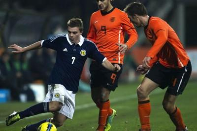 Scotland's James Forrest (left) skips past Netherlands duo Nacer Barazite and Stefan de Vrij (right).Picture: Sammy Turner/SNS