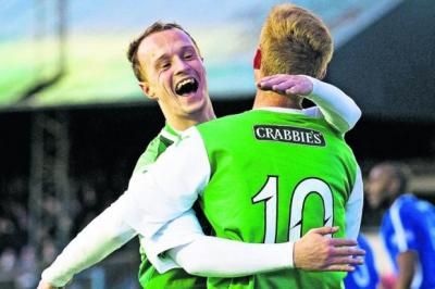 Leigh Griffiths, left, is first on hand to hail team-mate Eoin Doyle for scoring Hibs' second goal   Photograph: SNS