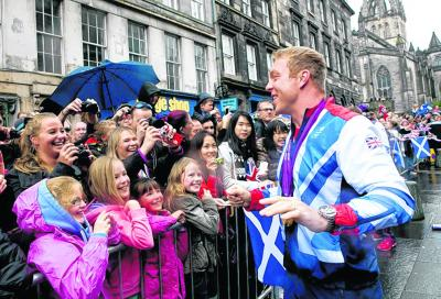 Sir Chris Hoy is the man of the moment during the recent Olympic parade in Edinburgh
