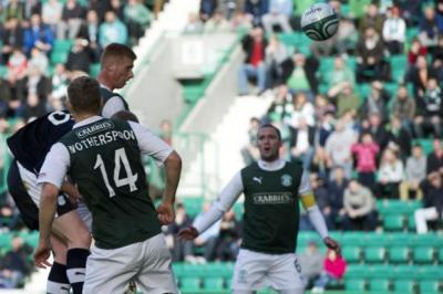 Eoin Doyle rises to head the ball home and open the scoring for Hibernian. Picture: SNS