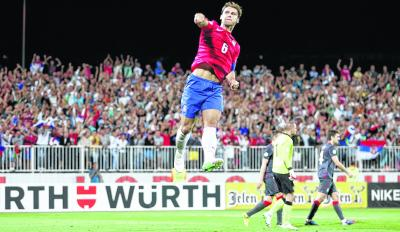 Serbia's Branislav Ivanovic celebrates scoring against Wales last month. Picture: Getty Images