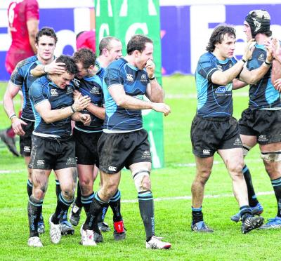 Warriors celebrate a try against Toulouse in 2009. Picture: SNS