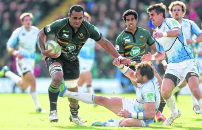 Northampton's Samu Manoa easily hands off Glasgow's Sean Lamont, while George Pisi, left, soars over for a try. Pictures:  Getty and PA