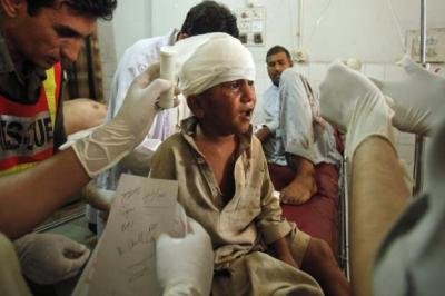 Children were among the 30 or more people injured in the car bomb                               attack on the main market in the town of Darra Adam Khel. At least 16 people were killed.Photograph: Reuters