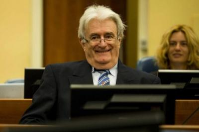 ACCUSED: Former Bosnian Serb leader Radovan Karadzic listened intently as the charges were read out at The Hague yesterday. Picture: EPA