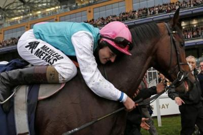 Tom Queally gives Frankel a hug after winning at Ascot   Photograph: Reuters